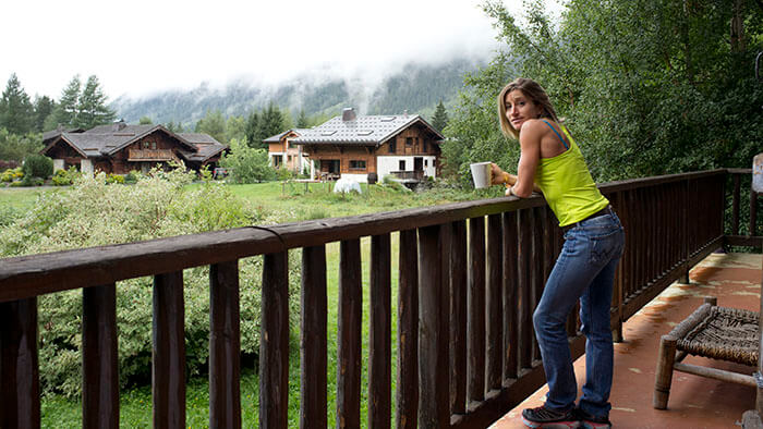 HOKA athlete Amandine Ferrato stands in her house overlooking the mountains