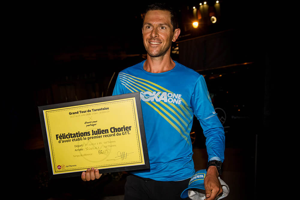 HOKA athlete Julien Chorier holds his record certificate