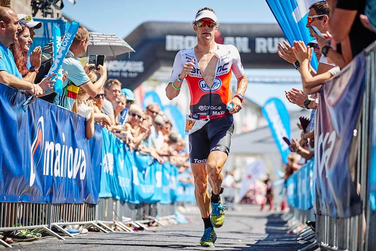 HOKA athlete Patrik Nilsson approaches the finish line at 2018 IM Frankfurt.