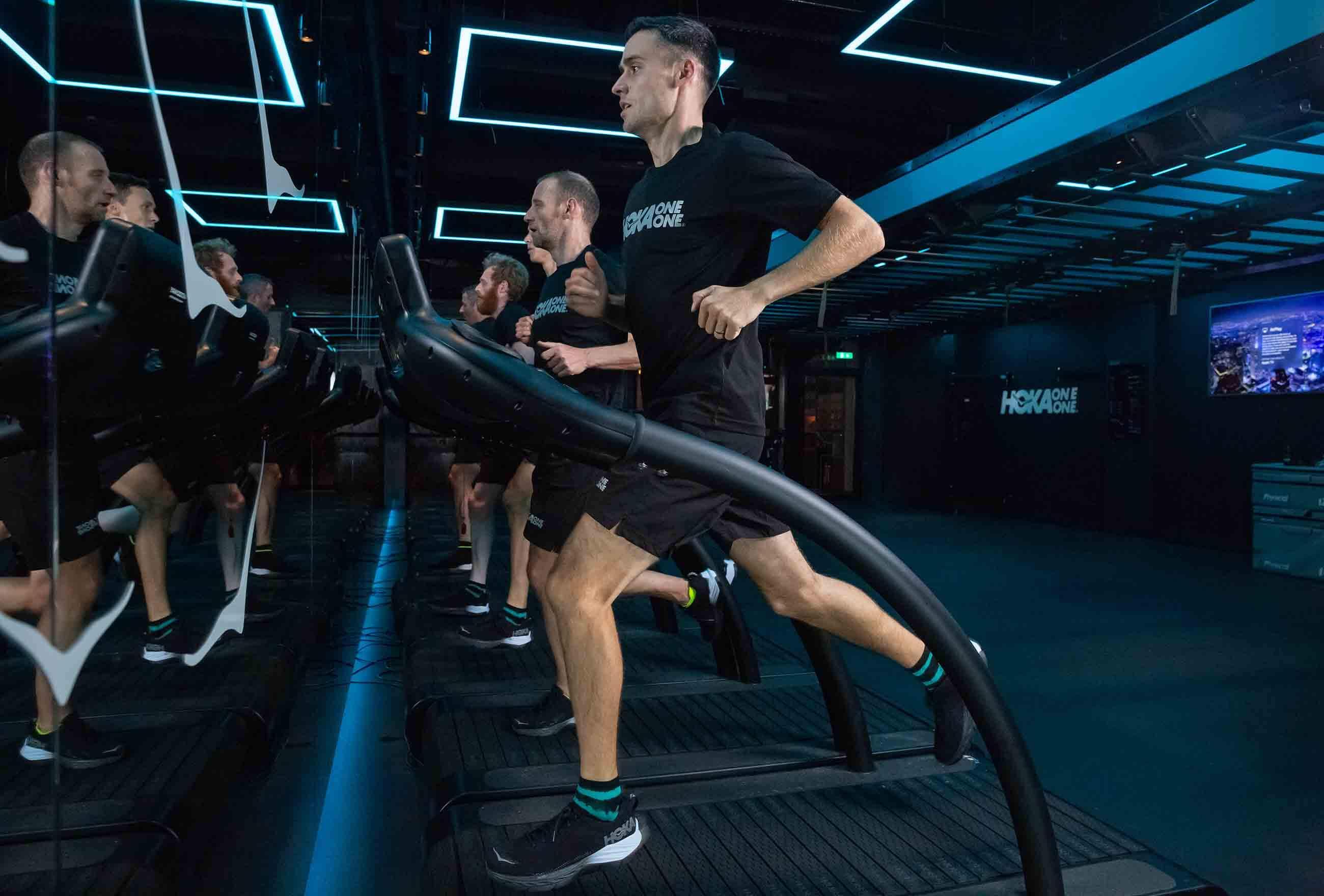 HOKA elite athlete Adam Hickey runs on the treadmill at the Fly at Night event in London