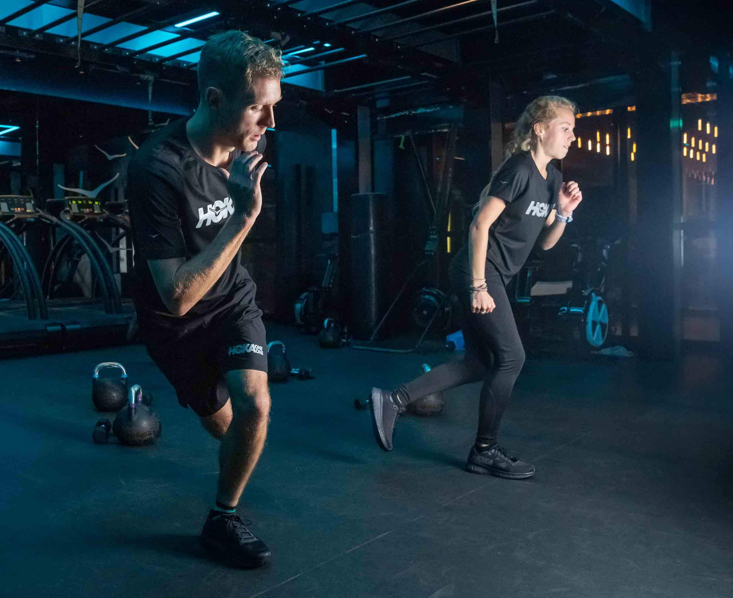 Participants do exercises at the HOKA Fly at Night event in London