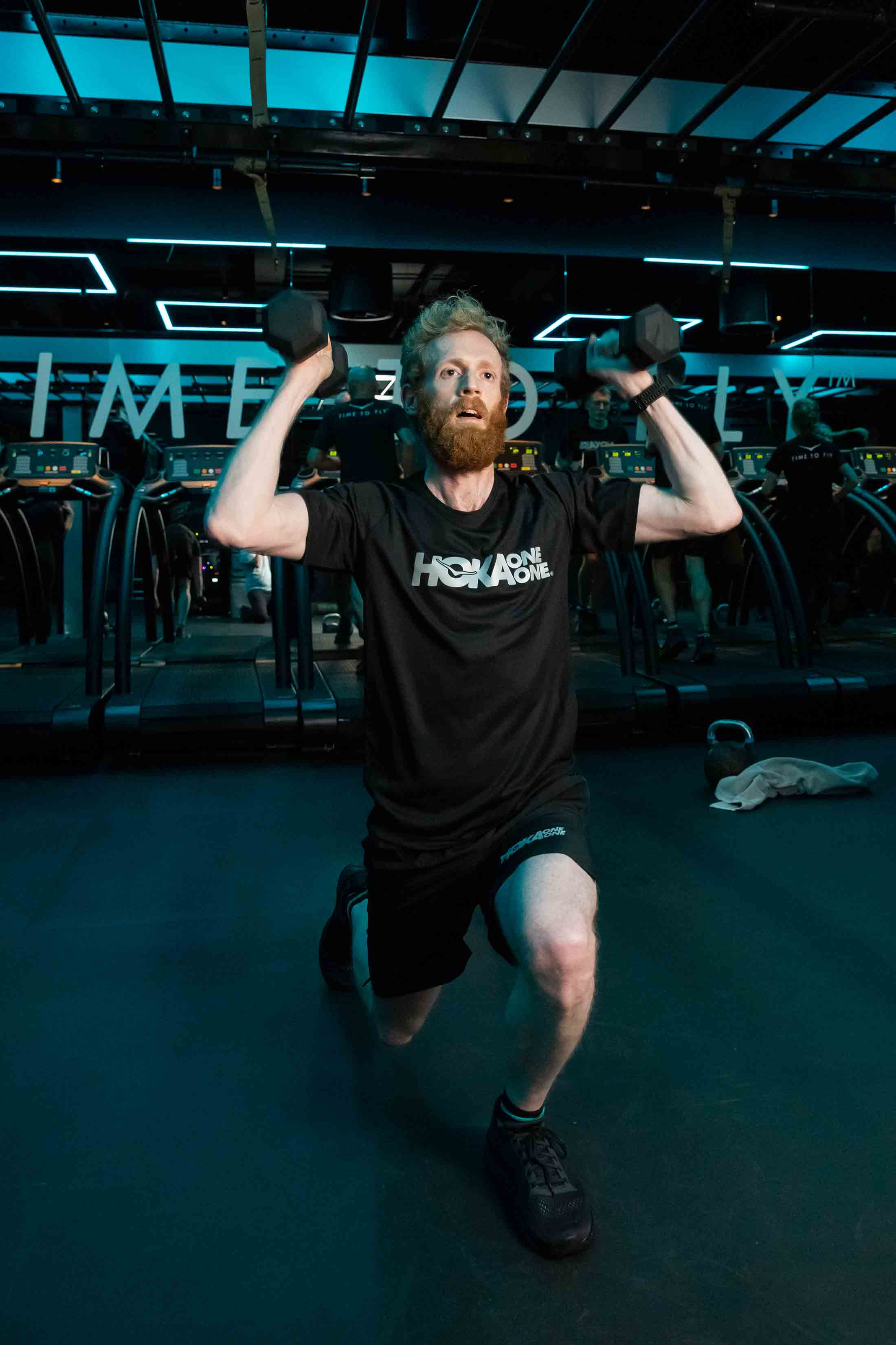 Participant lifts dumbbells at HOKA Fly at Night event in London