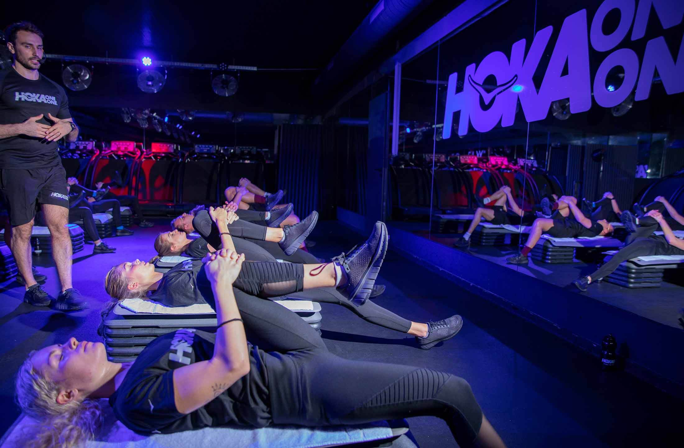 Participants stretch off at HOKA Fly at Night event in London