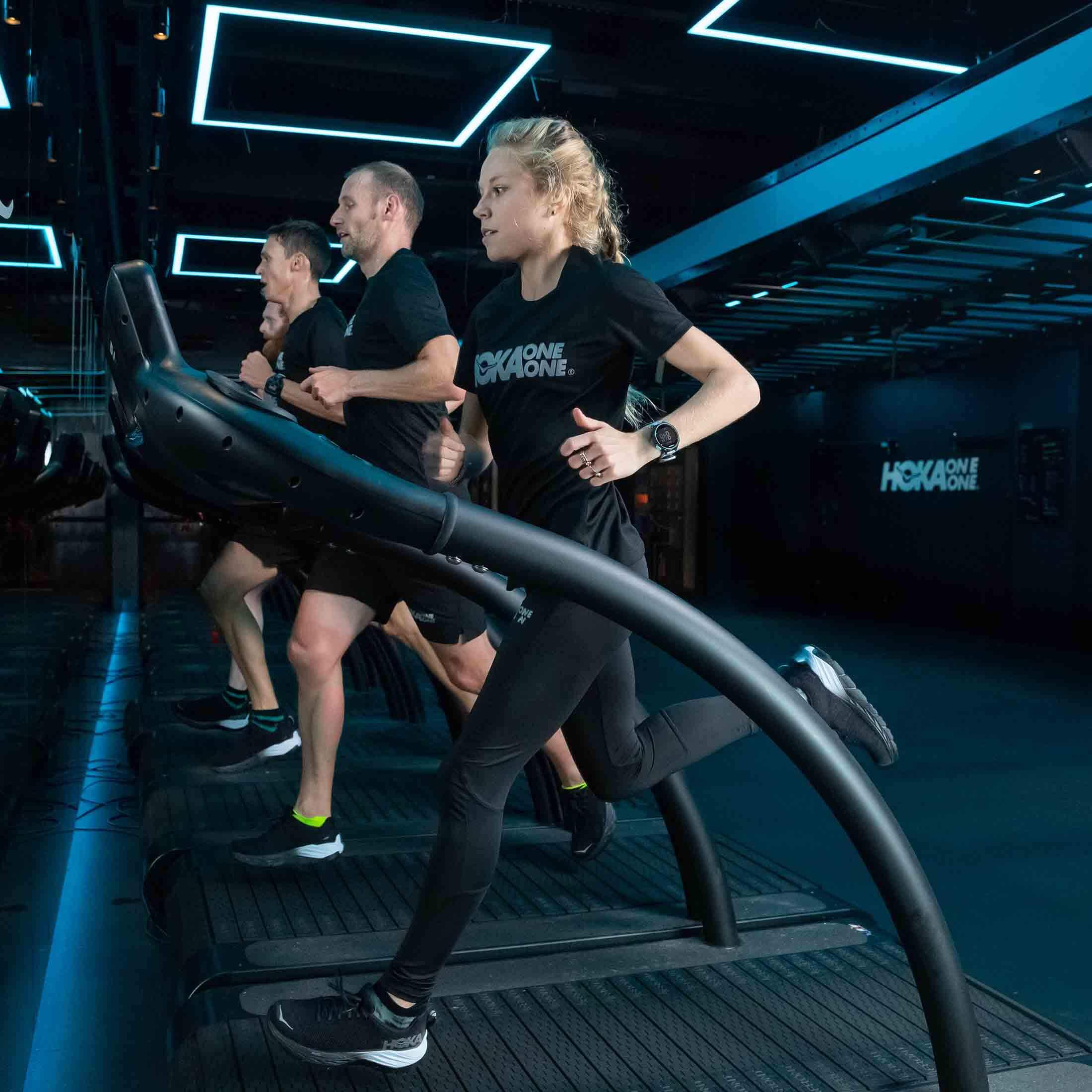 HOKA elite athlete Jenny Nesbitt runs on the treadmill at the Fly at Night event in London
