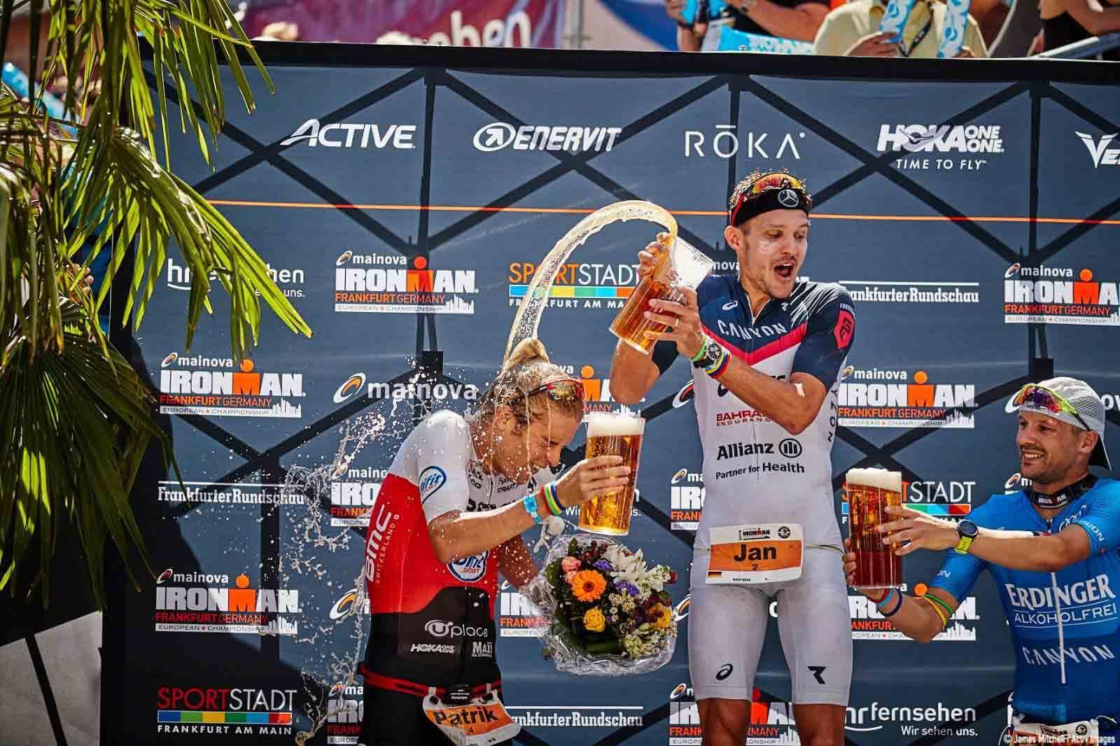 HOKA athlete Patrik Nilsson on the podium at 2018 IRONMAN Frankfurt.