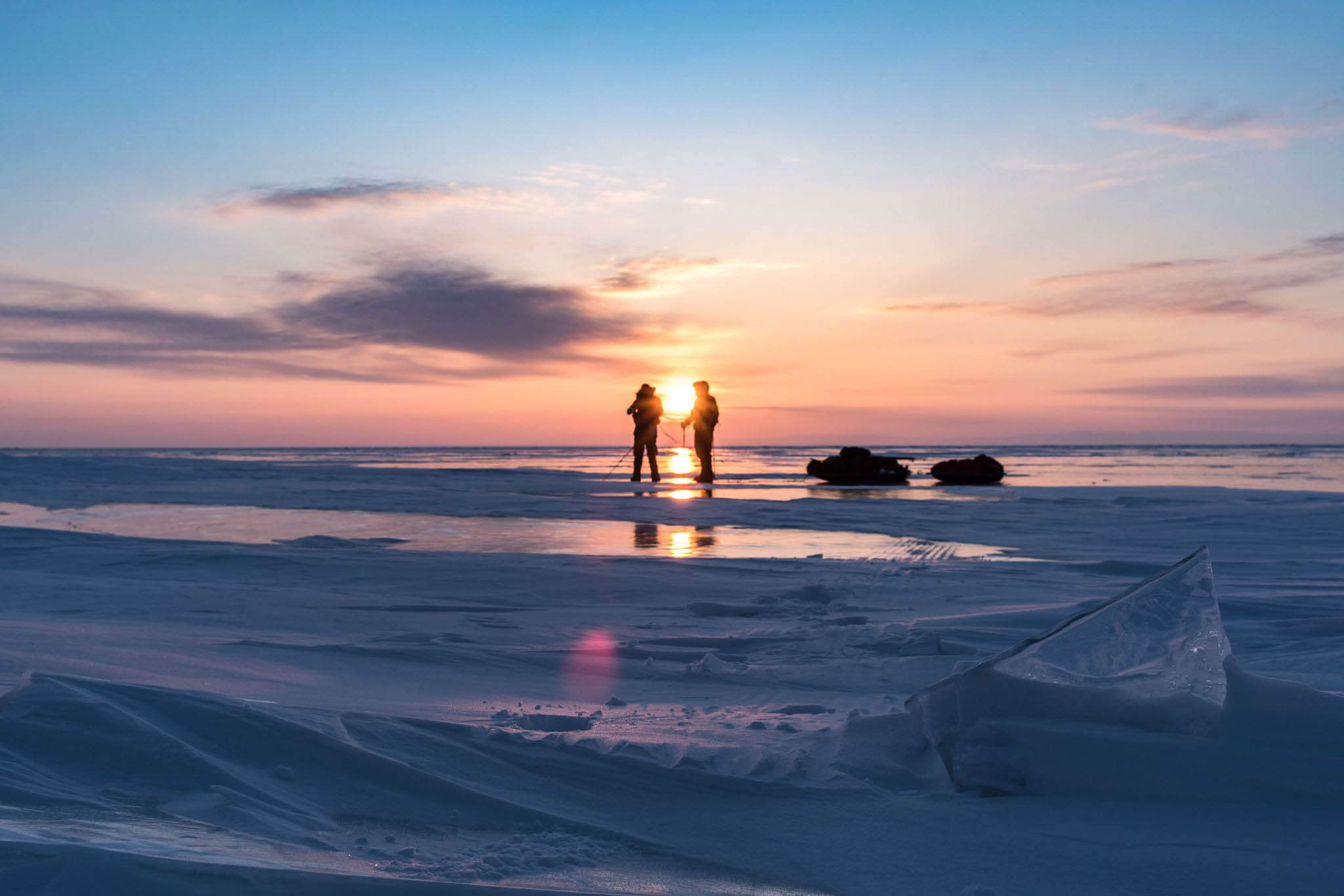 HOKA fan Rob Trigwell watches the sunset on Lake Baikal
