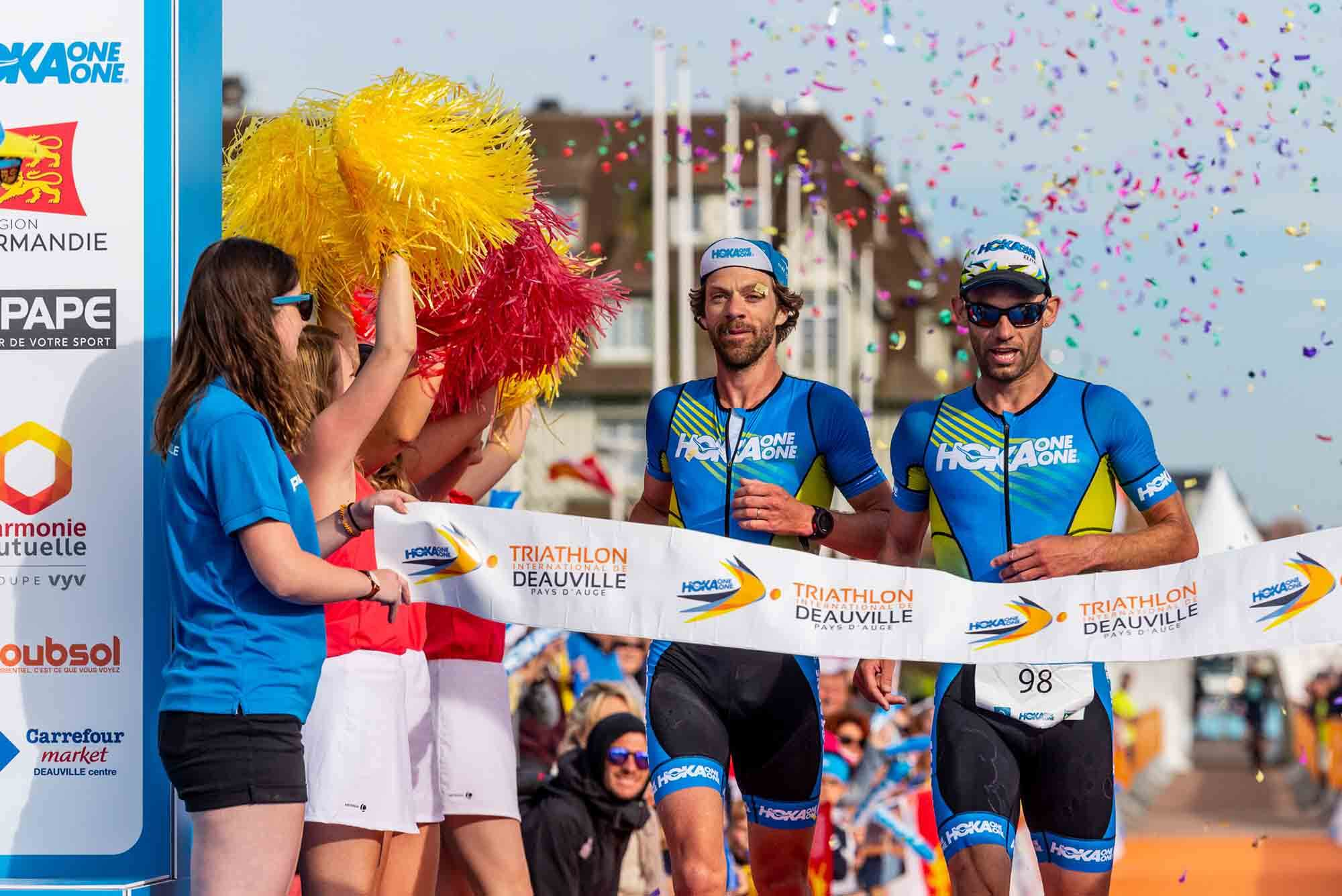 HOKA athletes Antoine Perel and Olivier Lyoen cross the line first at the 2018 Deauville Triathlon