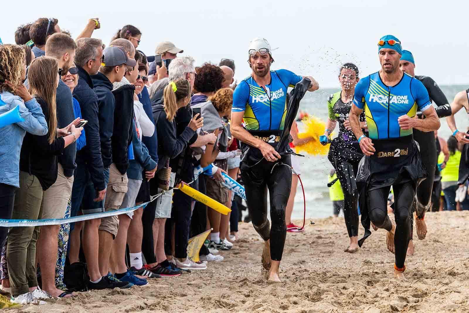 HOKA athletes Antoine Perel and Olivier Lyoen running on the beach at the 2018 Deauville Triathlon