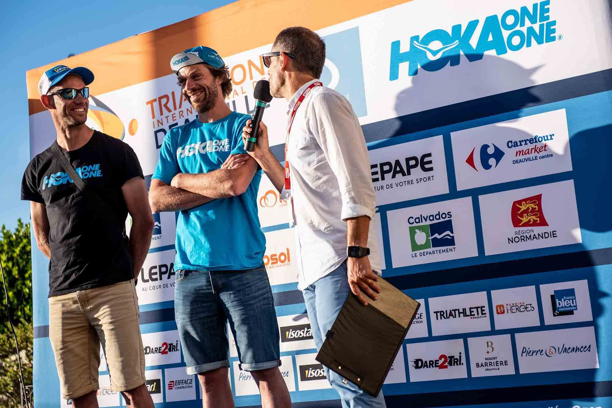 HOKA athletes Antoine Perel and Olivier Lyoen interviewed at an event