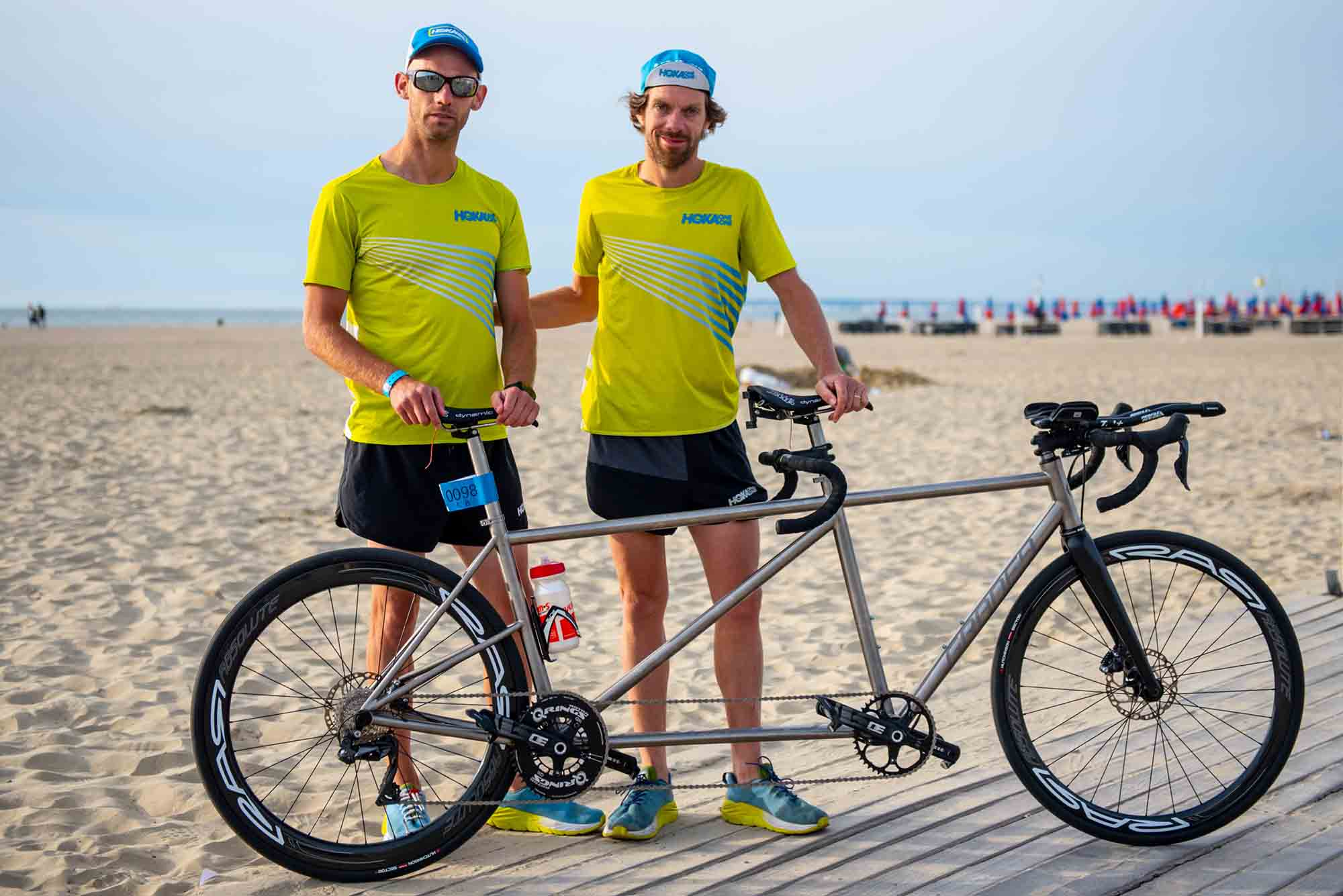 HOKA athletes Antoine Perel and Olivier Lyoen stand by their tandem bike