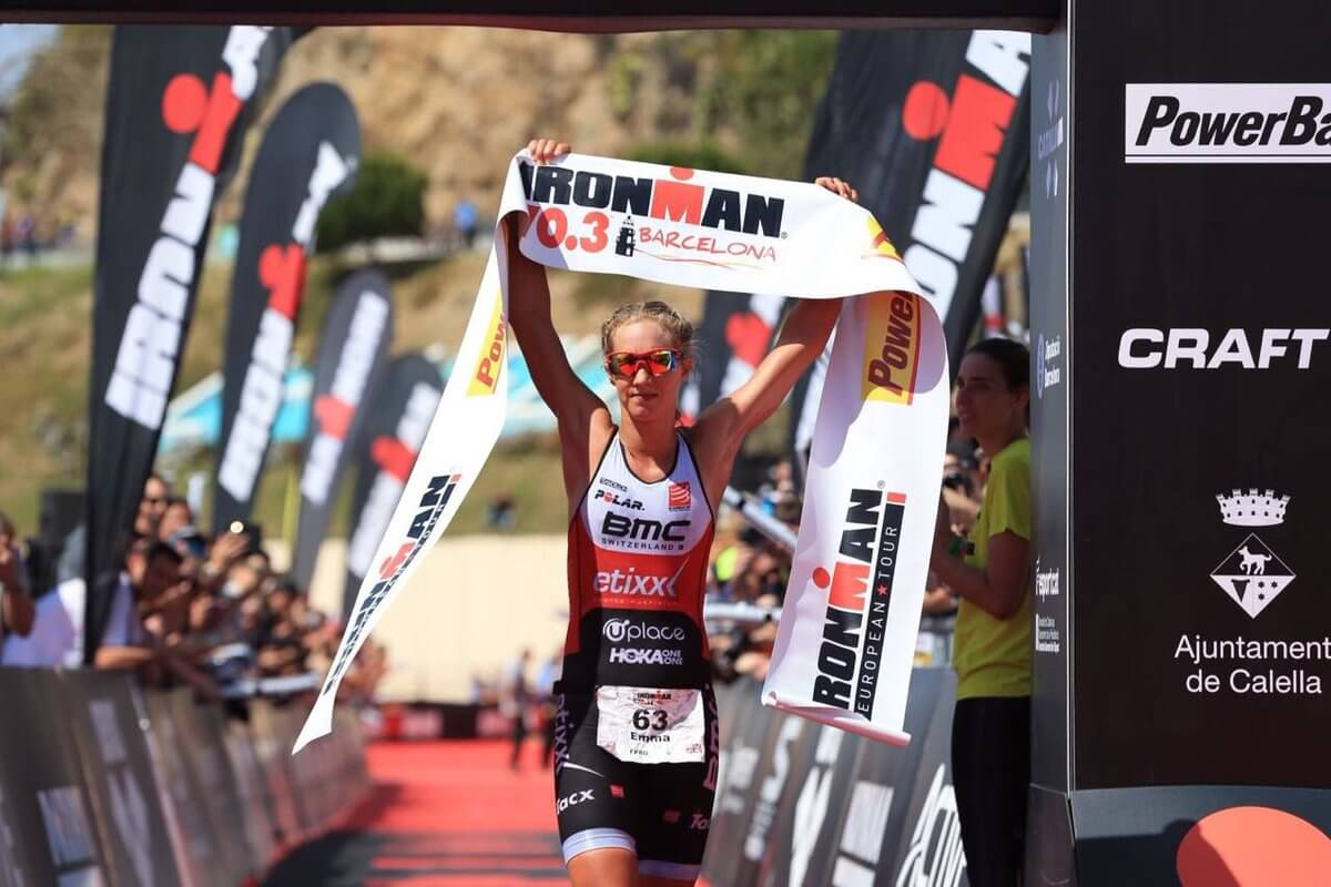 HOKA athlete Emma Pallant crosses the line at 2018 IRONMAN 70.3 Barcelona