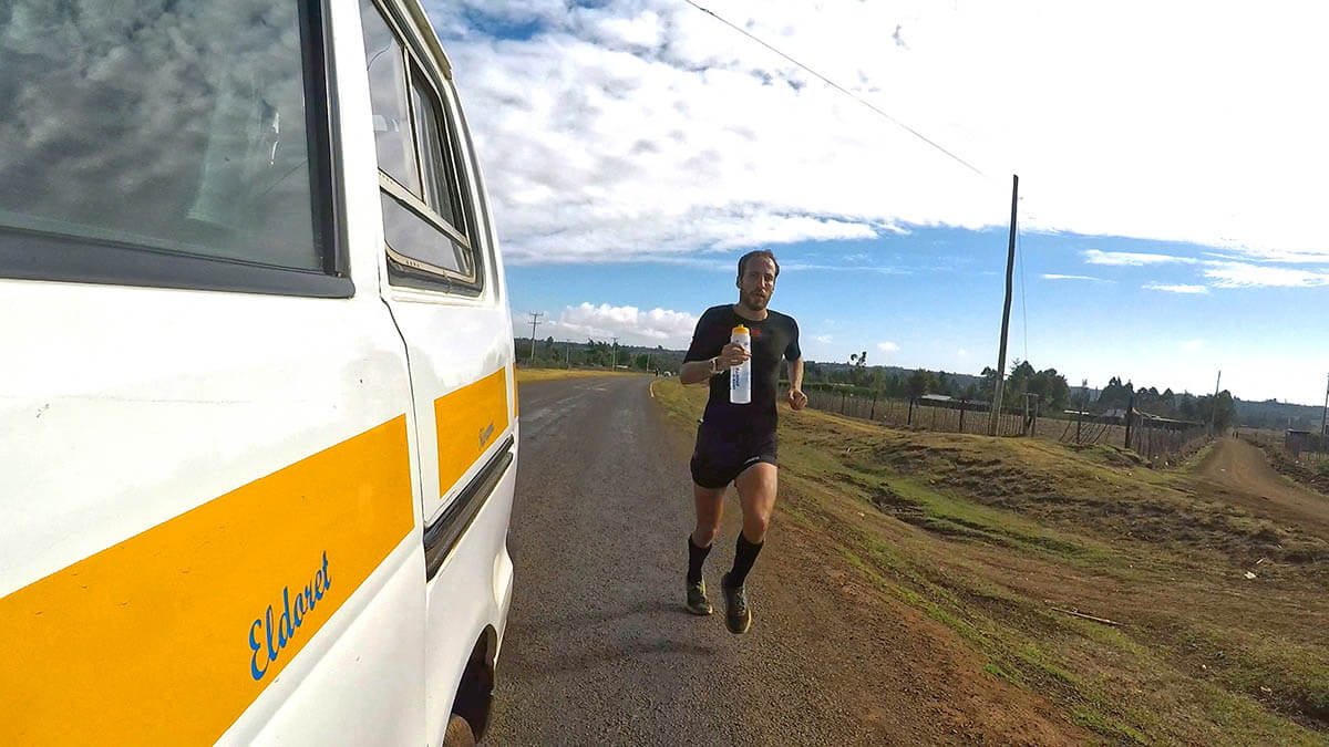 HOKA athlete Frank Schauer trains on the roads following a car