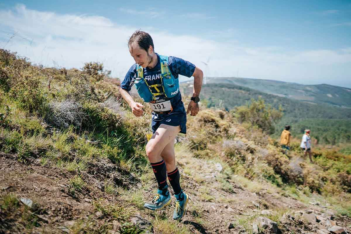 HOKA athlete Nicolas Martin runs up a hill