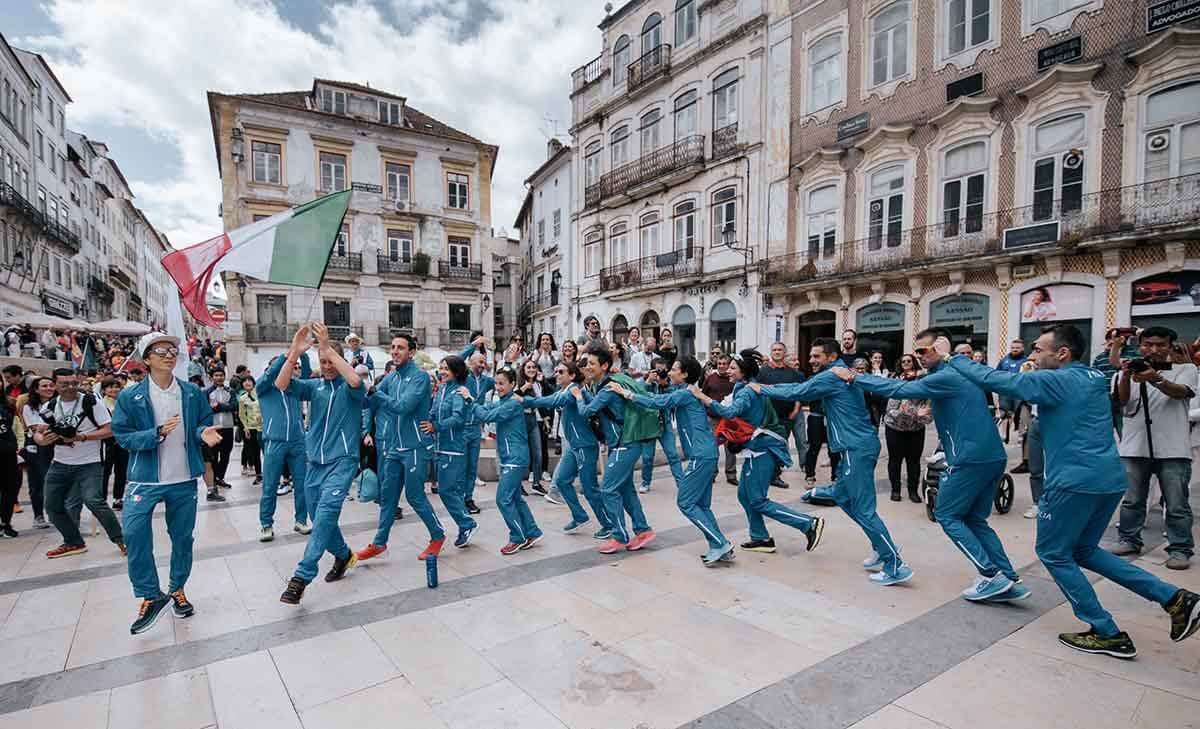 Team Italy do the conga in the town square