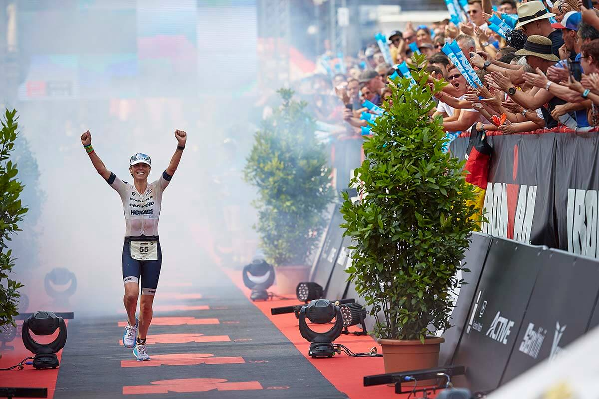 HOKA athlete Susie Cheetham celebrates winning Ironman Hamburg