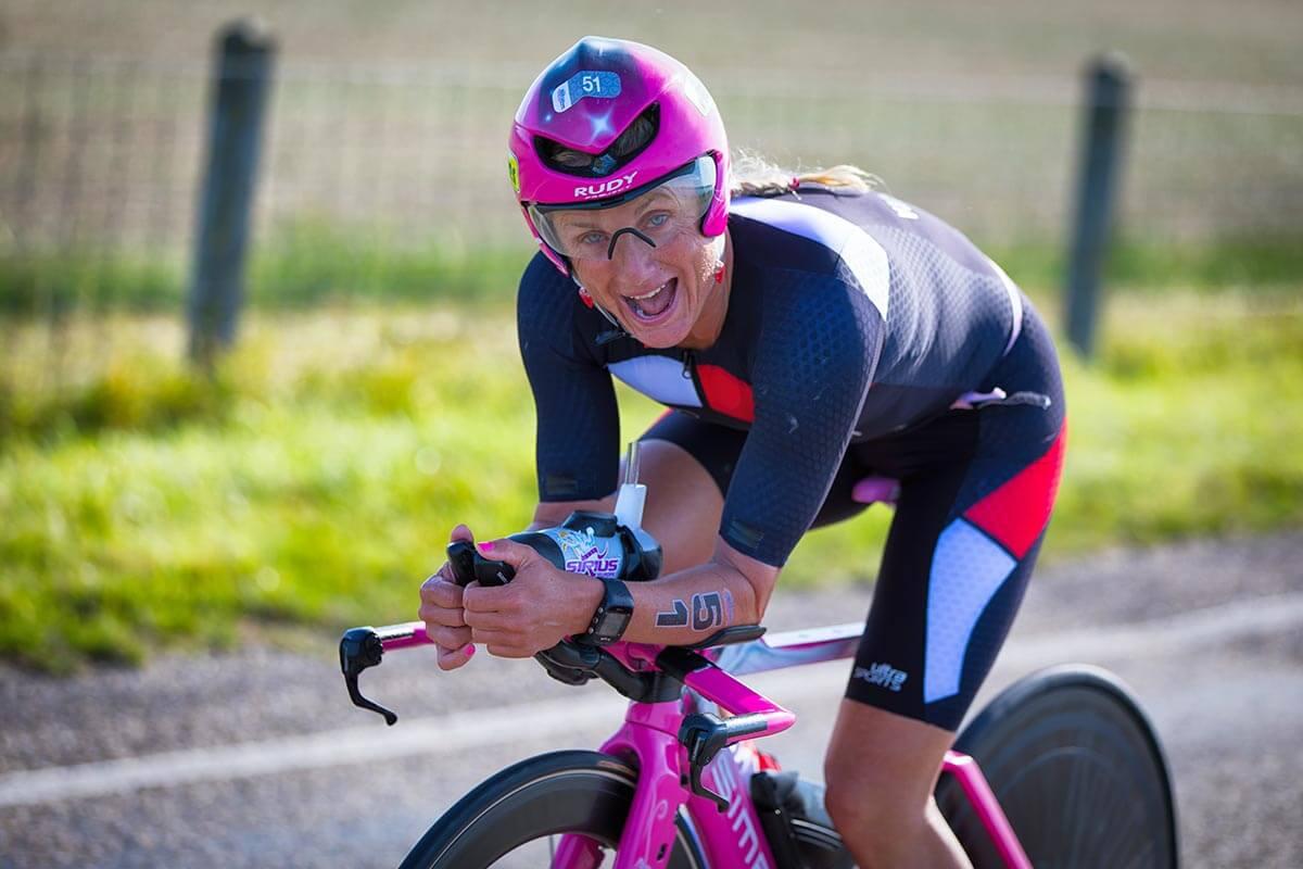 HOKA athlete Yvonne van Vlerken smiles on the bike at Challenge Almere