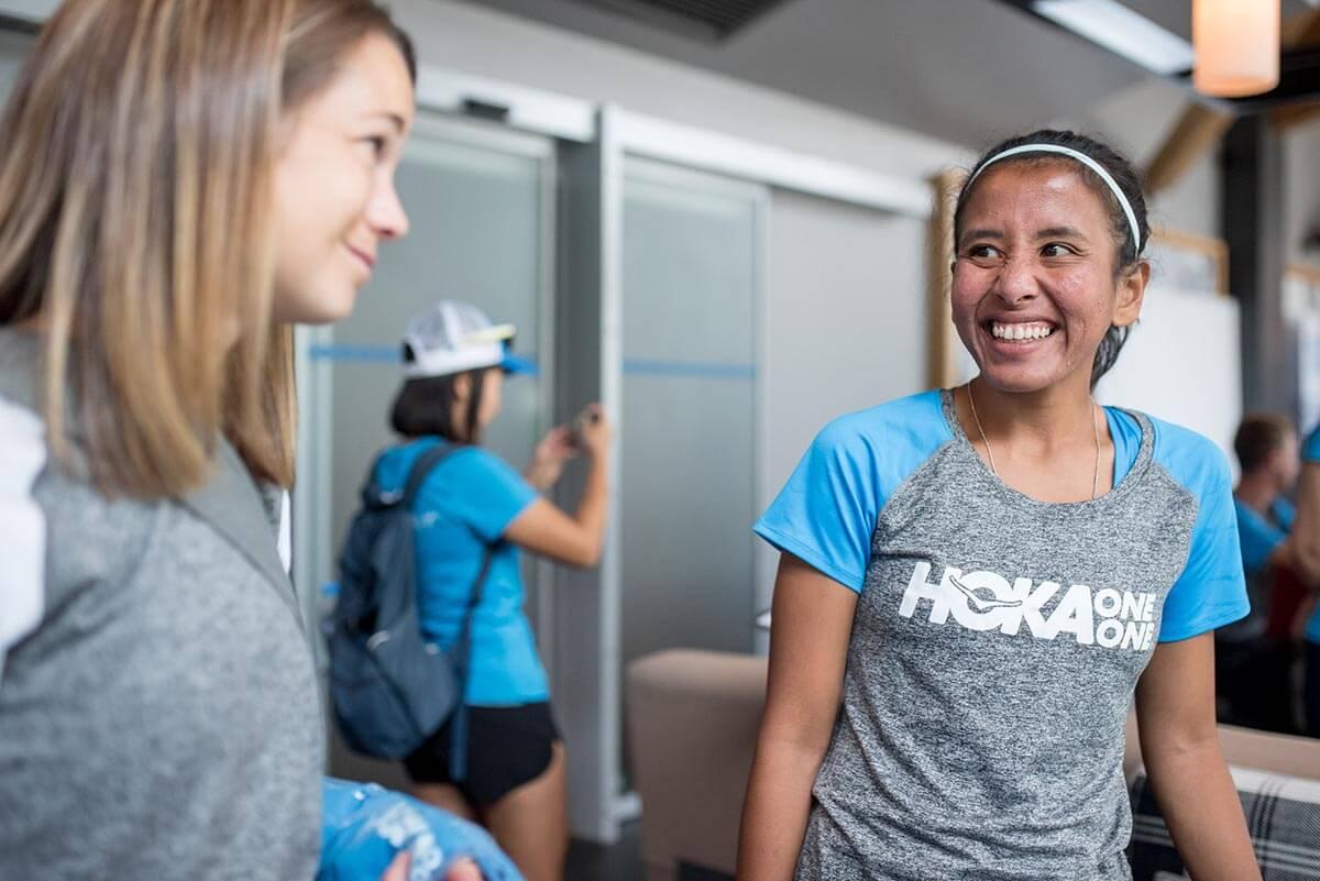 HOKA athletes Ruth Theresia and Kaci Lickteig chat and smile
