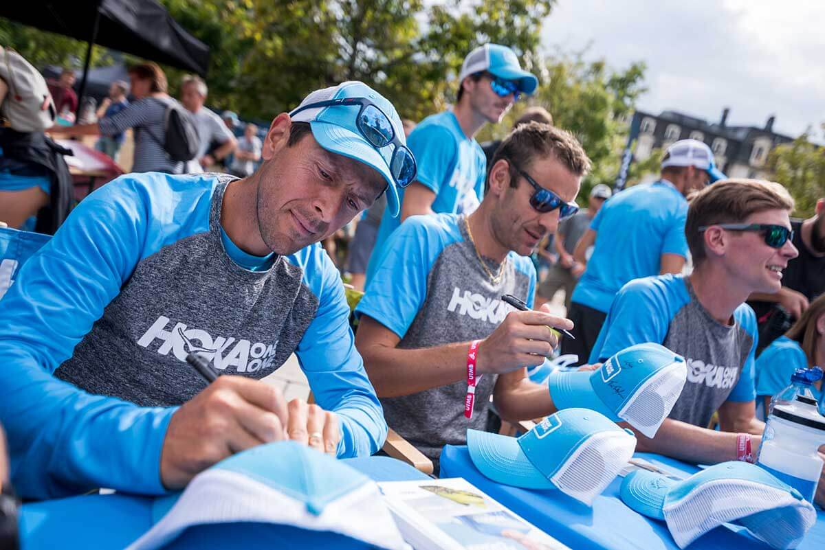 Team HOKA line up at the signing session