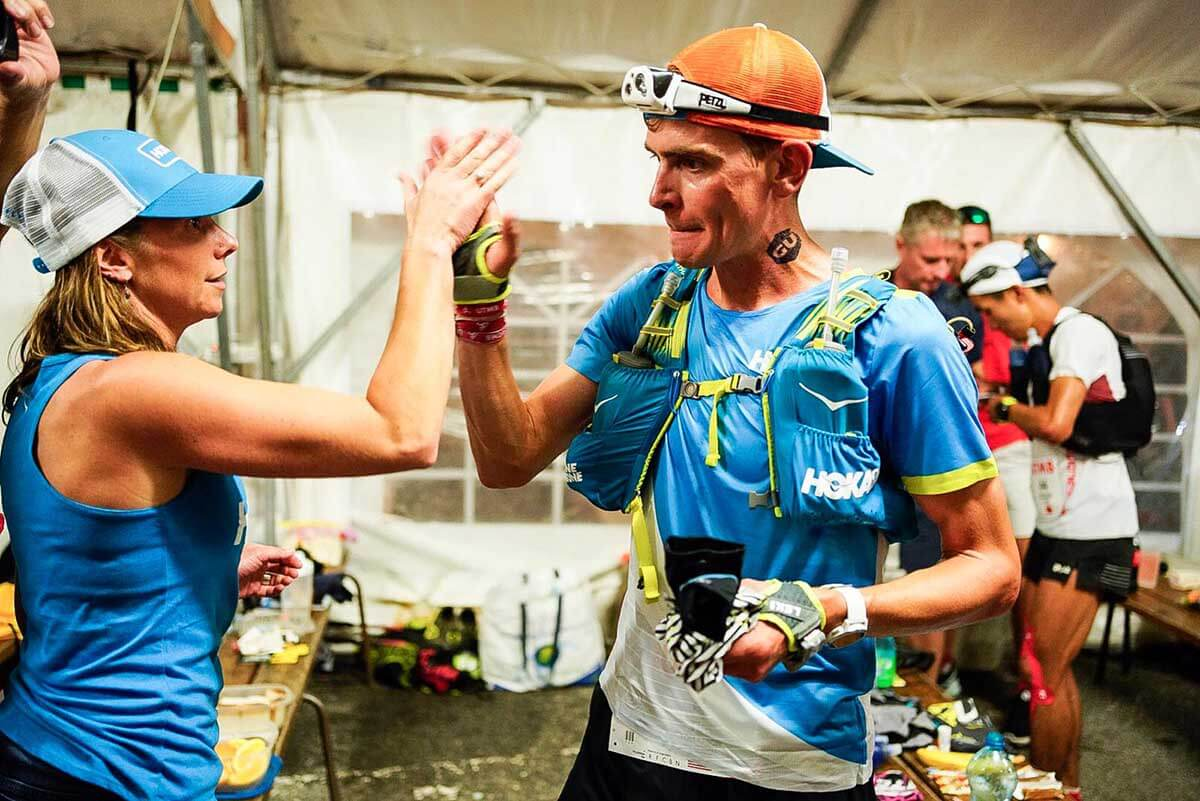 HOKA athlete Tim Tollefson at an aid station