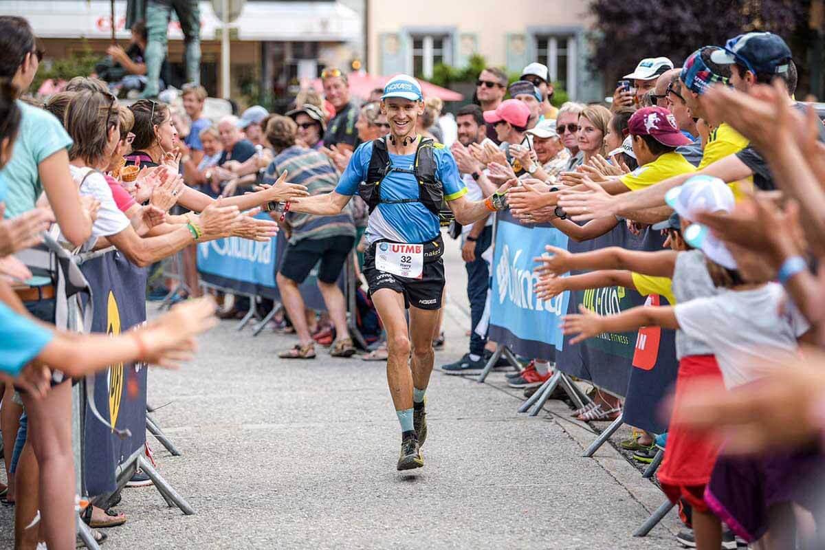 HOKA athlete Harry Jones high-fives the crowd into the finish