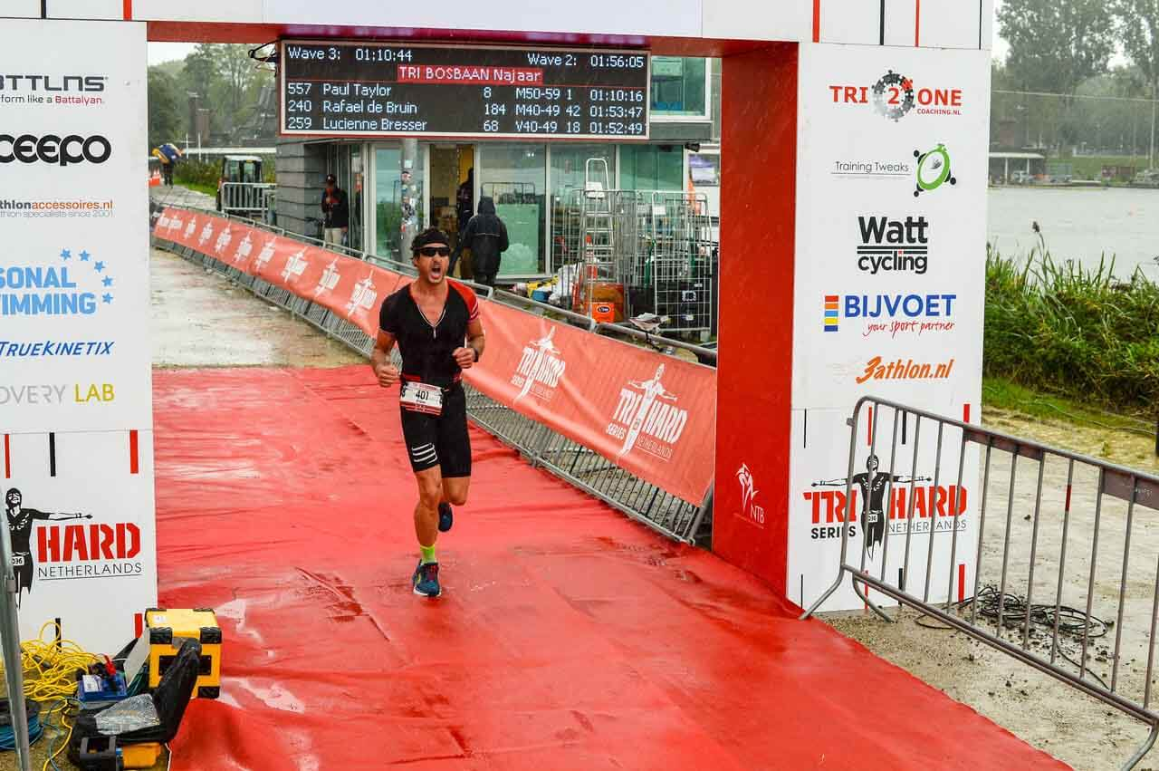 HOKA fan Frans crosses the line in his triathlon