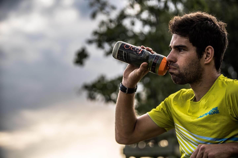 HOKA athlete Joe Skipper drinks from a water bottle