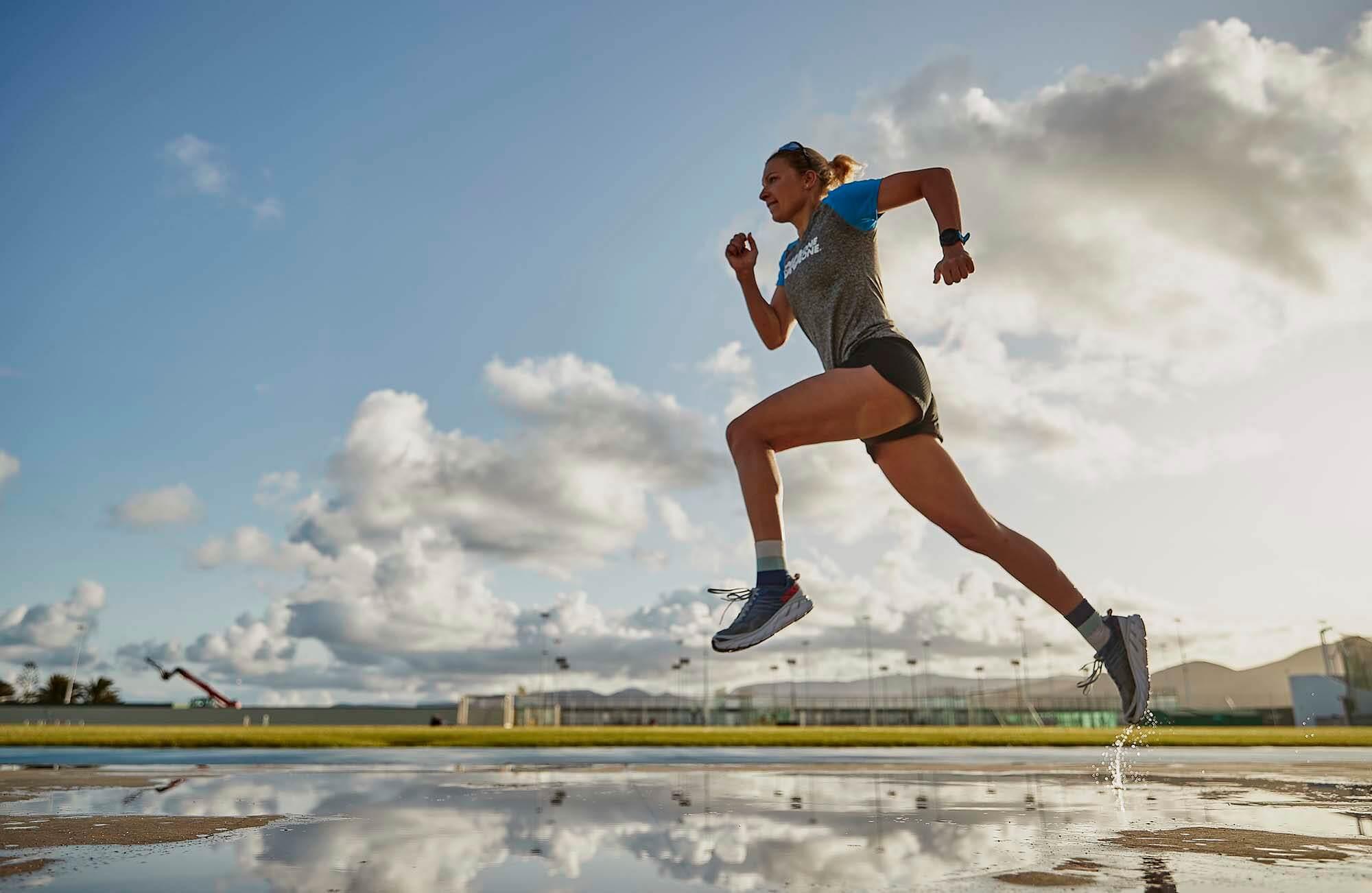 HOKA athlete Carolin Lehrieder runs across the wet ground
