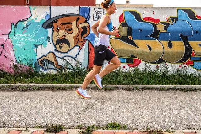 HOKA athlete Nikki Bartlett runs in the sun