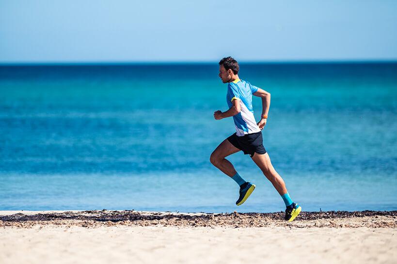 HOKA athlete Thibat Garrivier runs across the beach