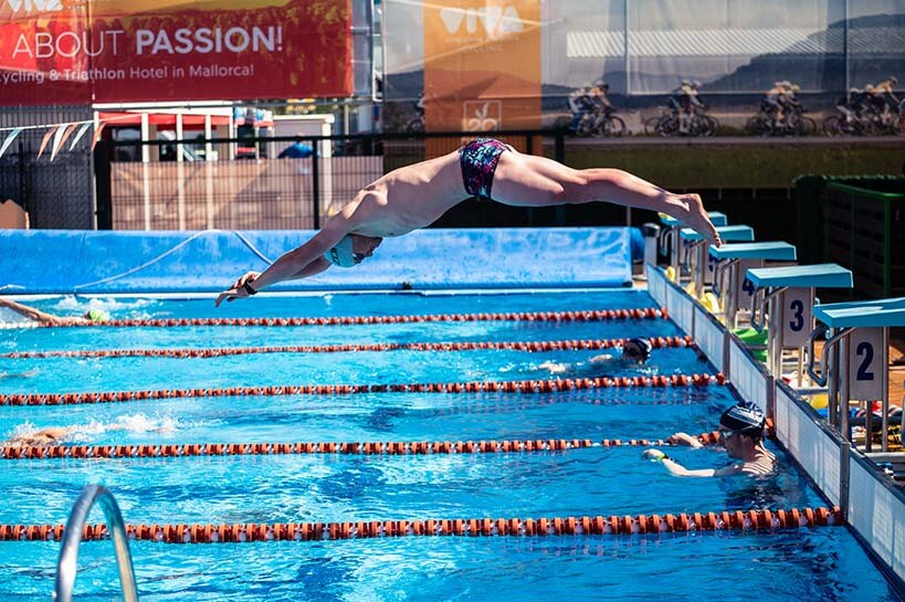 HOKA athlete Sam Proctor dives into the pool