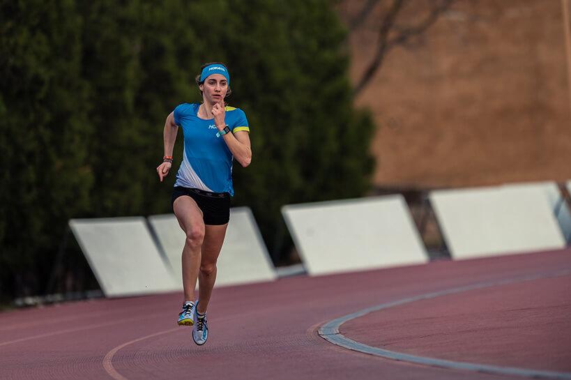 HOKA athlete Lucie Lerebourg sprints round the bend