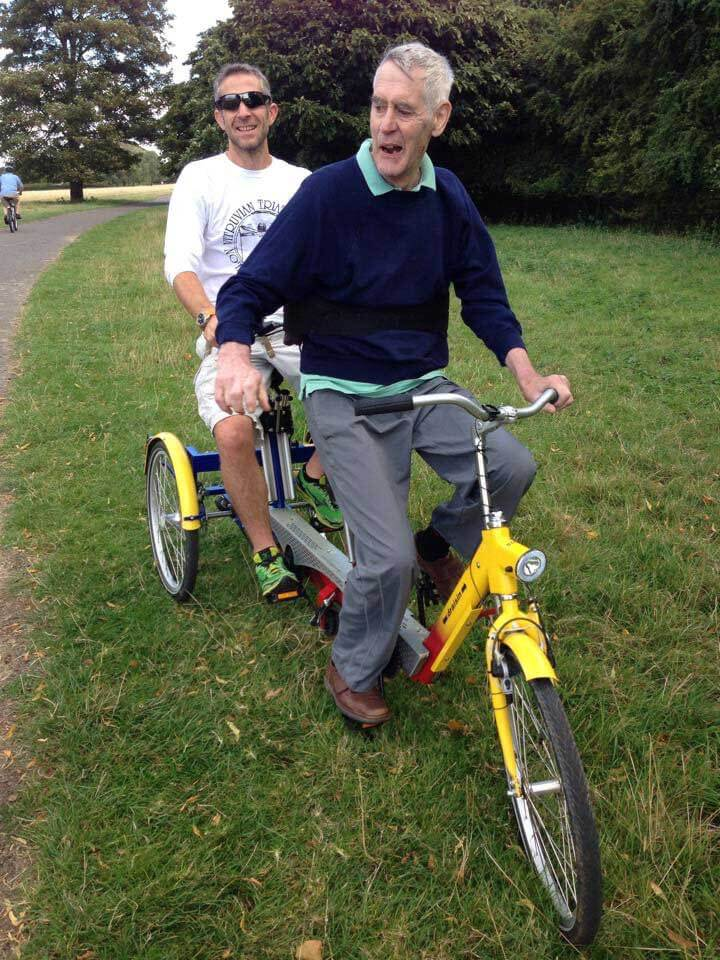 HOKA fan Tom with his father on a bicycle