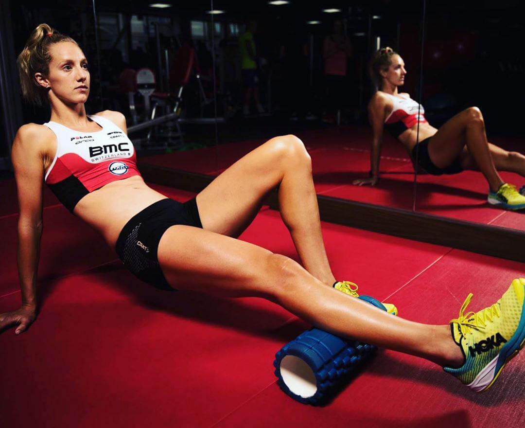 HOKA athlete Emma Pallant uses the foam roller