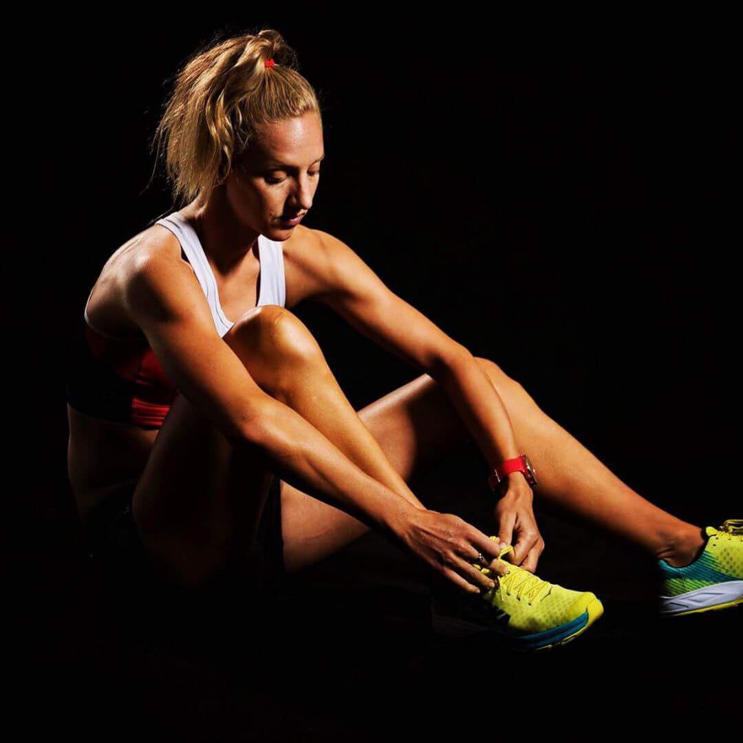 HOKA athlete Emma Pallant ties her shoelaces