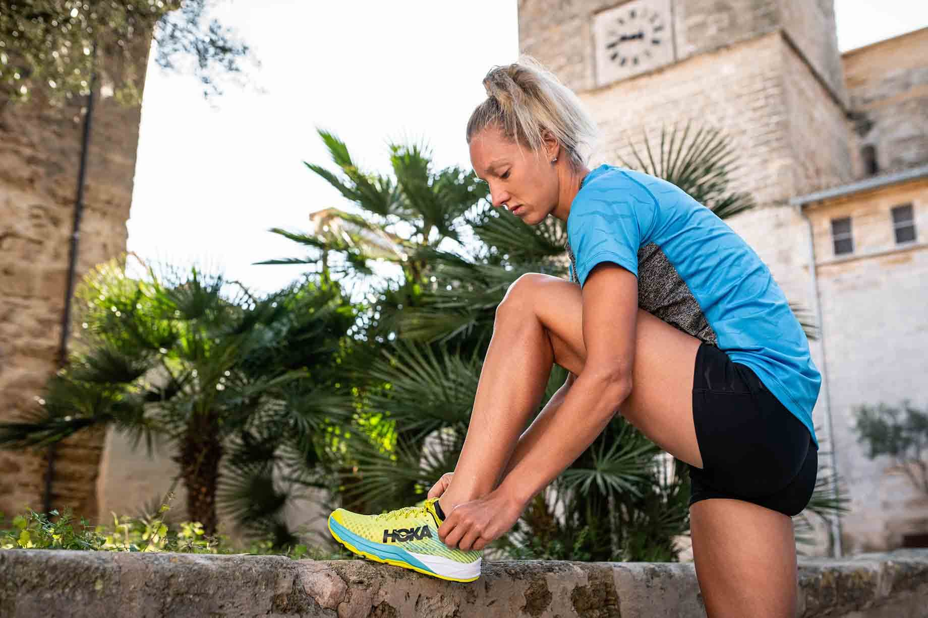 HOKA athlete Emma Pallant ties her shoelaces Carbon Rocket