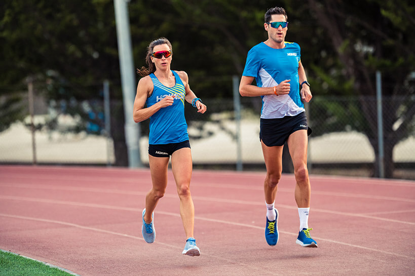 HOKA athletes Manon Genet and Arnaud Guilloux at the athletics track