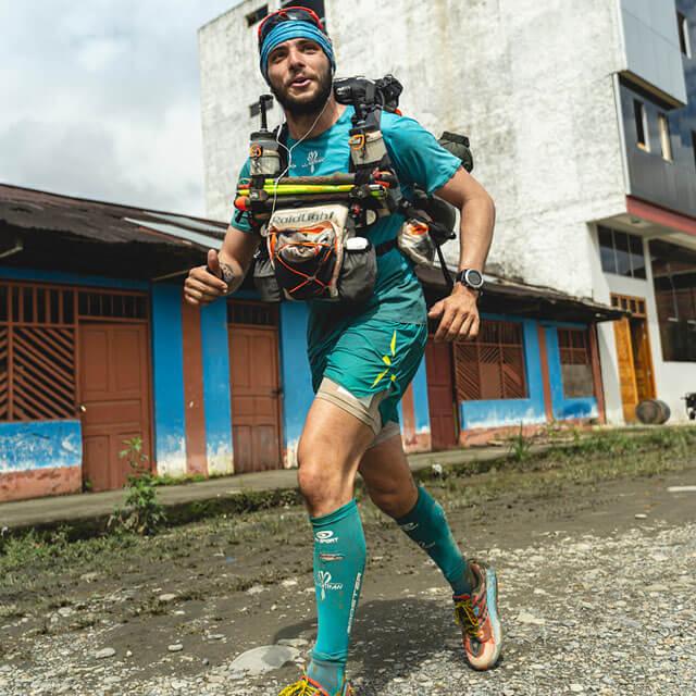 HOKA fan Mael Jouan runs through the streets on day three