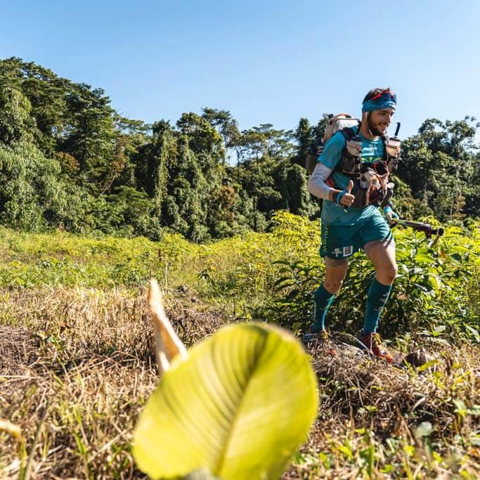HOKA fan Mael Jouan runs through grassland