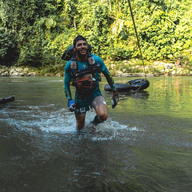 HOKA fan Mael Jouan runs through the river